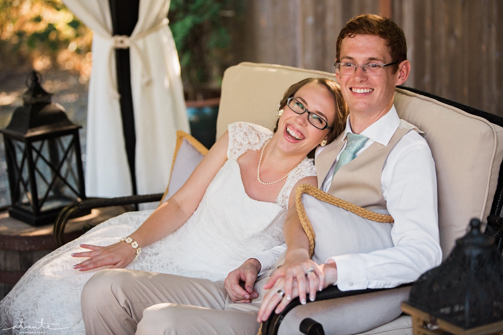 bride_and_groom_in_chaise_lounge