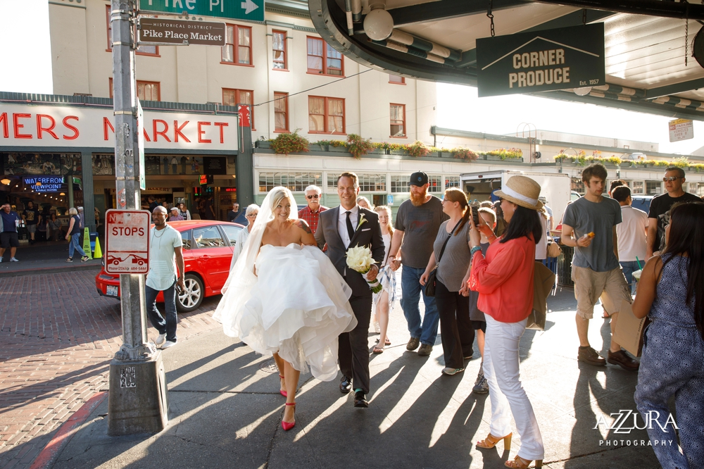 bride_and_groom_walk_through_pike_place_market