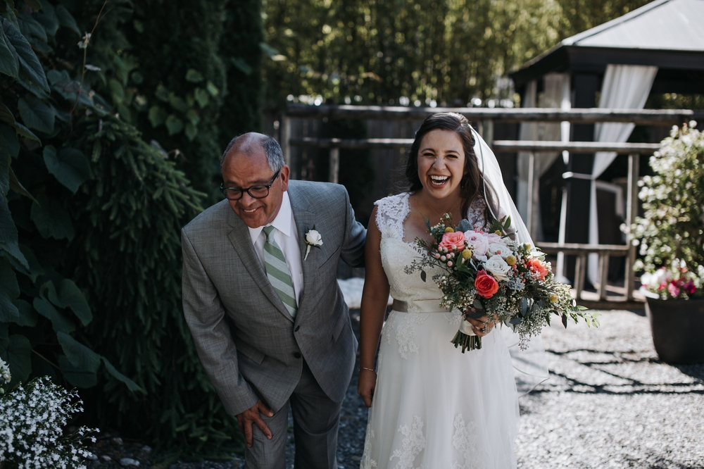 bride_laughing_with_father