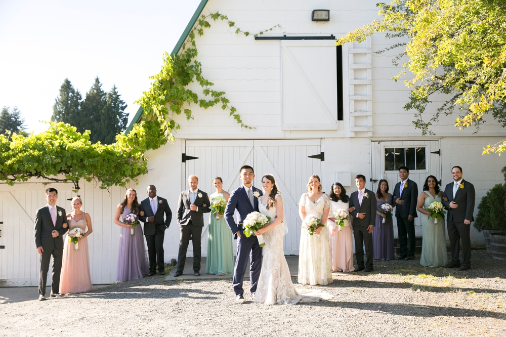 bridal-party-in-front-of-barn