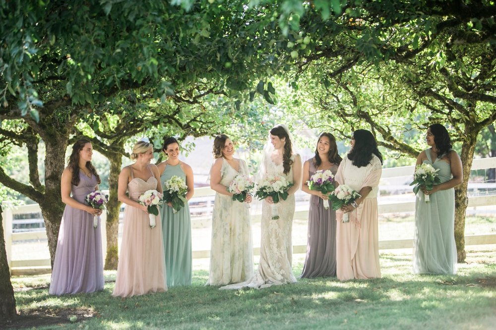 bride-and-bridesmaids-in-orchard