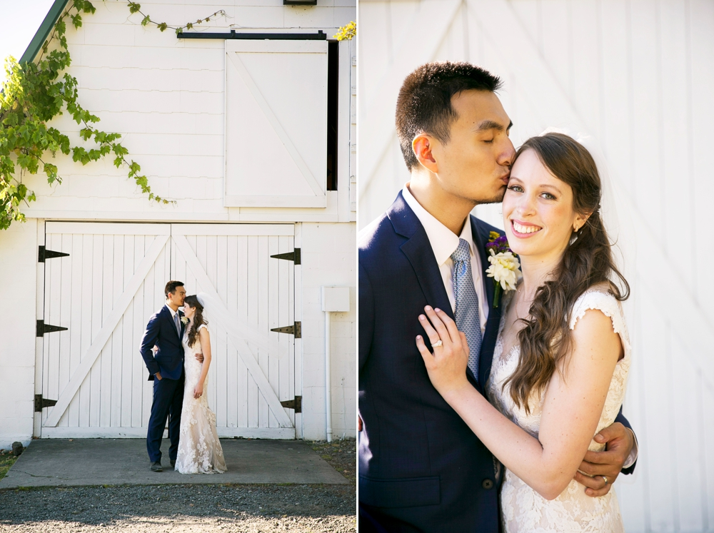 bride-and-groom-in-front-of-barn
