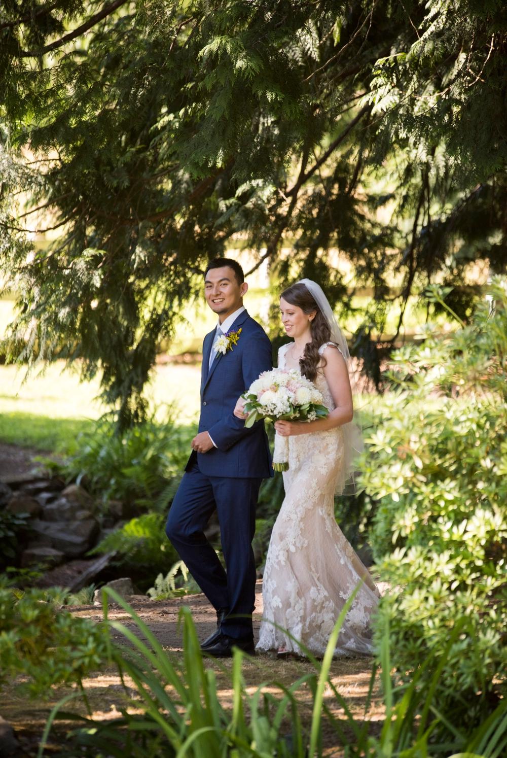groom-ushers-bride-down-the-aisle