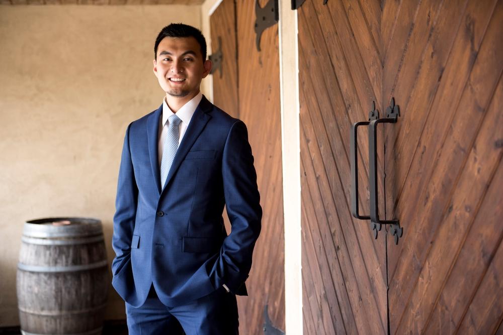 groom-standing-in-front-of-cellar-door