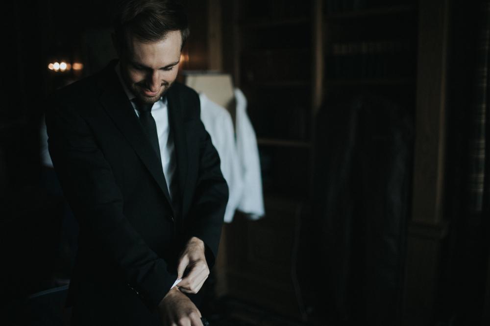 groom-fixing-his-cuff