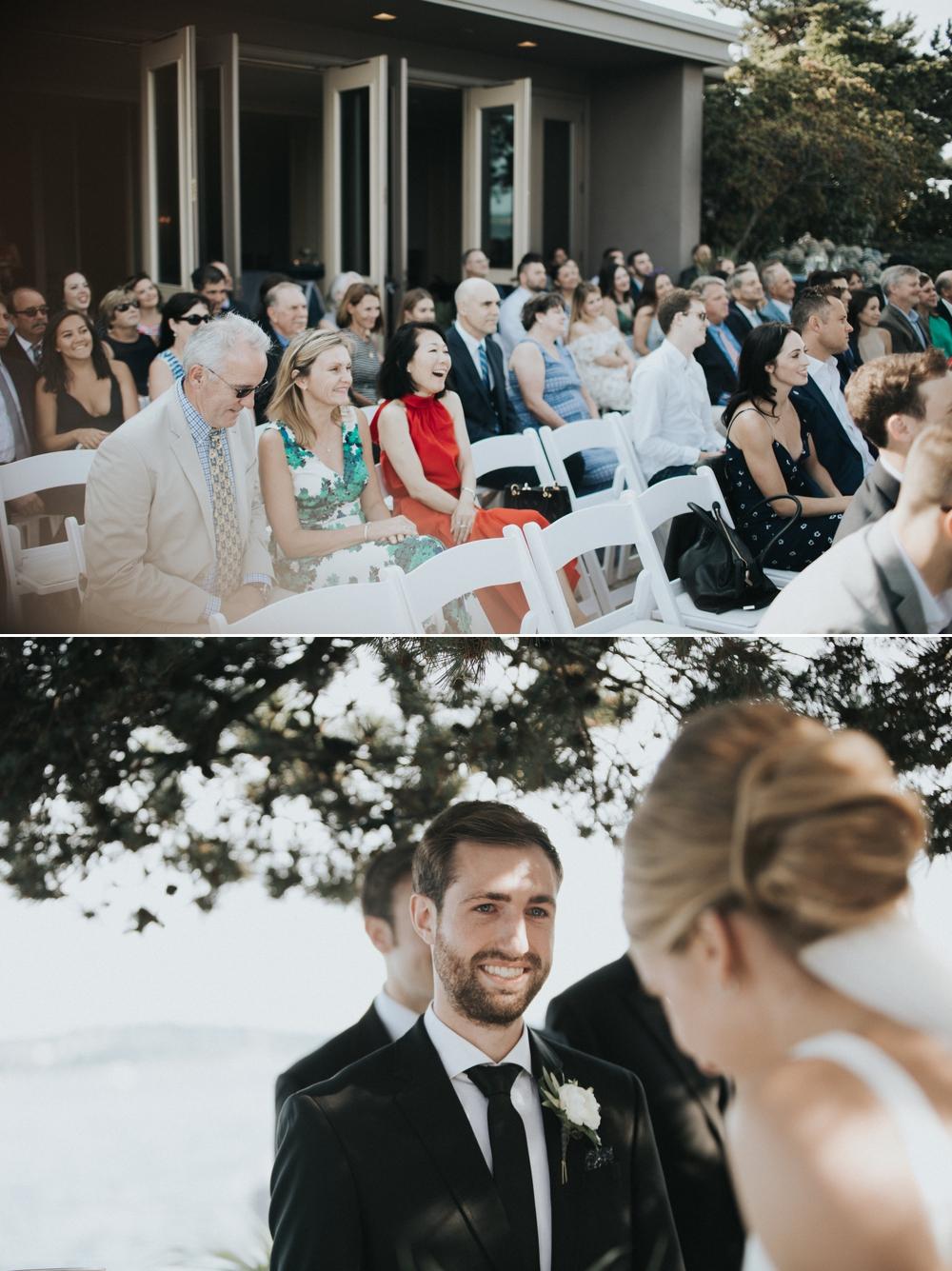 wedding-guests-smile-as-groom-sees-bride