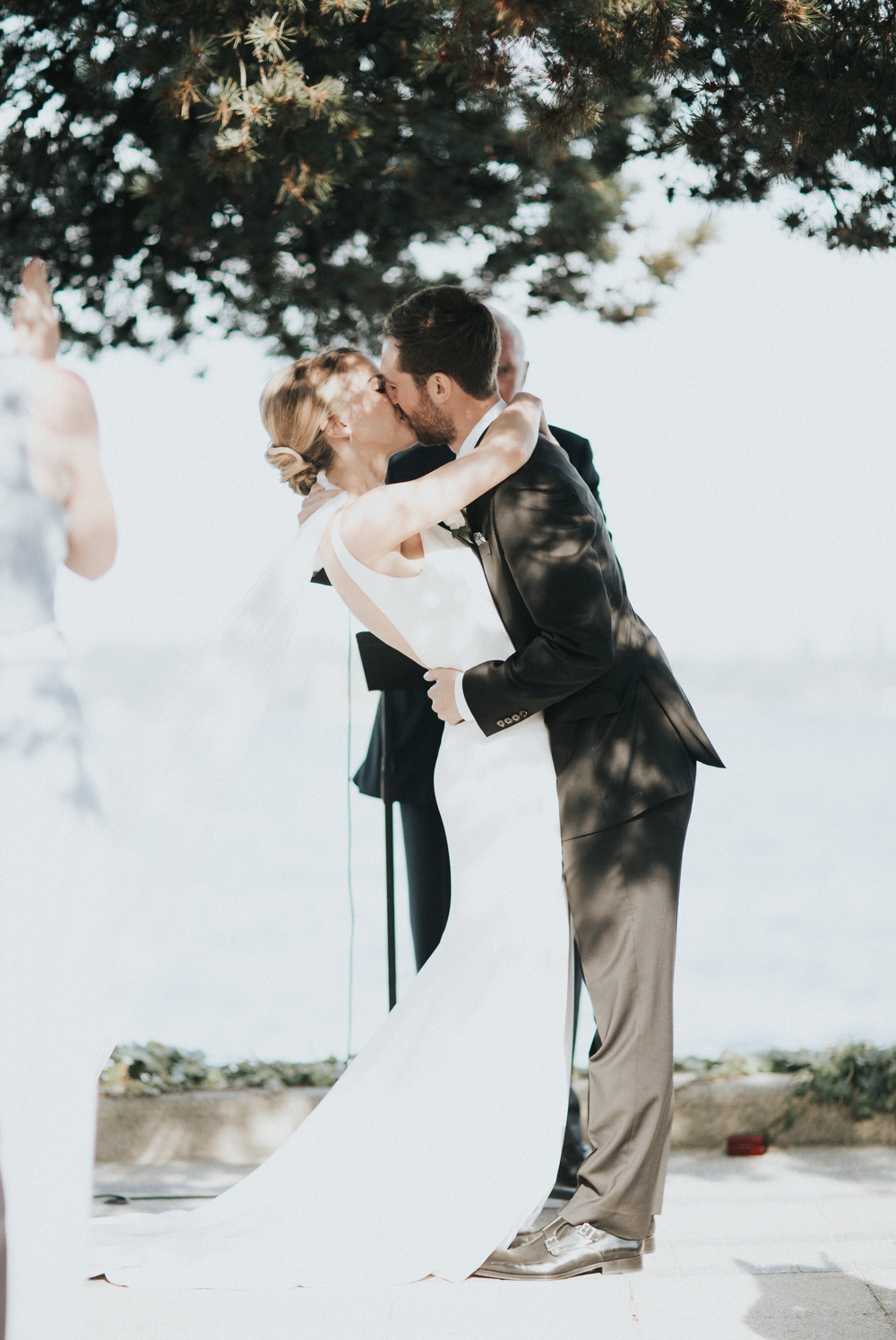 kiss-at-seattle-waterfront-wedding-ceremony