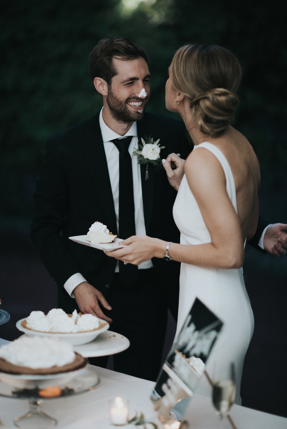bride-smears-frosting-on-grooms-nose