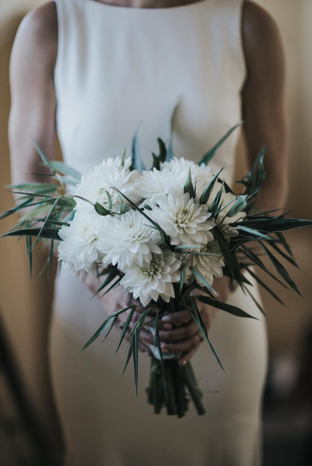 bride-holding-white-wedding-bouquet