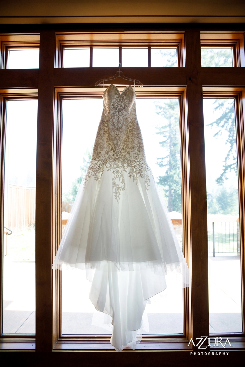 strapless-beaded-wedding-gown-hanging-in-the-window