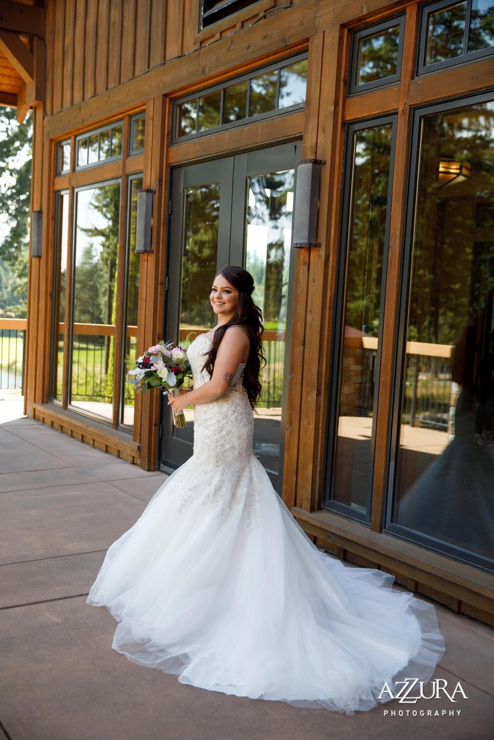 bride-with-bouquet-looking-over-her-shoulder
