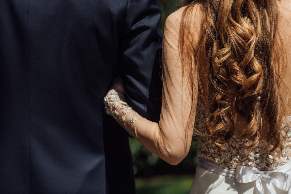 bride-grips-fathers-arm