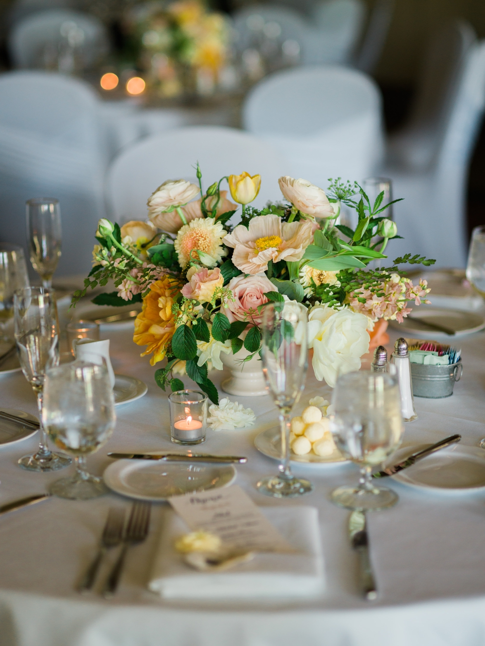 yellow-and-pink-flowers-on-tables