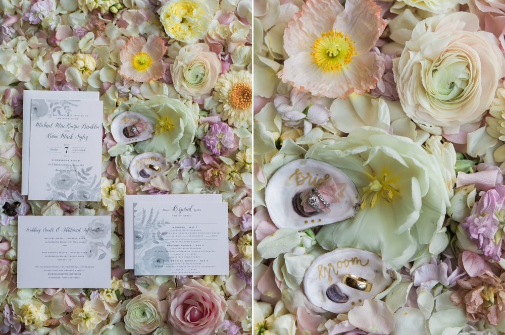 wedding-invitations-and-rings-on-a-bed-of-flowers