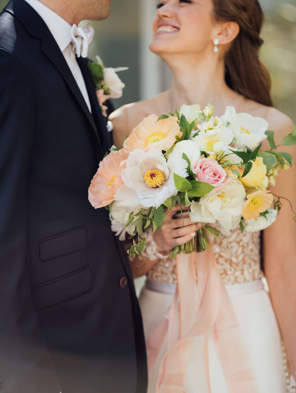 close-up-of-bride-holding-white-pink-and-yellow-bouquet