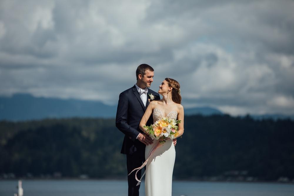bride-and-groom-on-dock-at-alderbrook