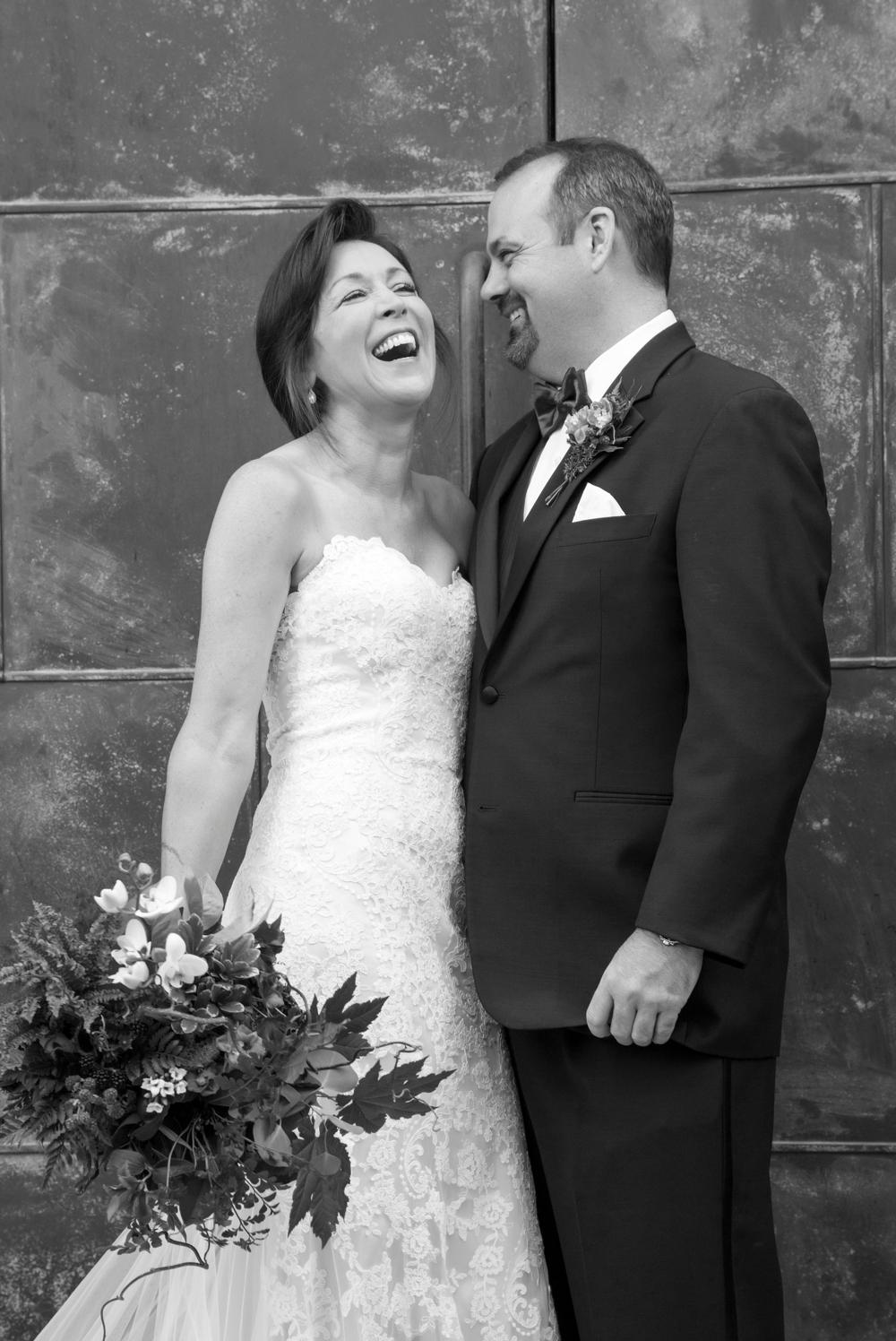 bride-and-groom-in-front-of-copper-door-at-JM-cellars