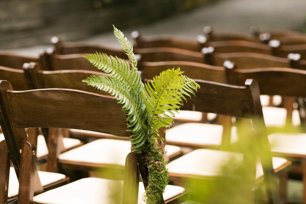 ferns-decorate-chairs-in-aisle