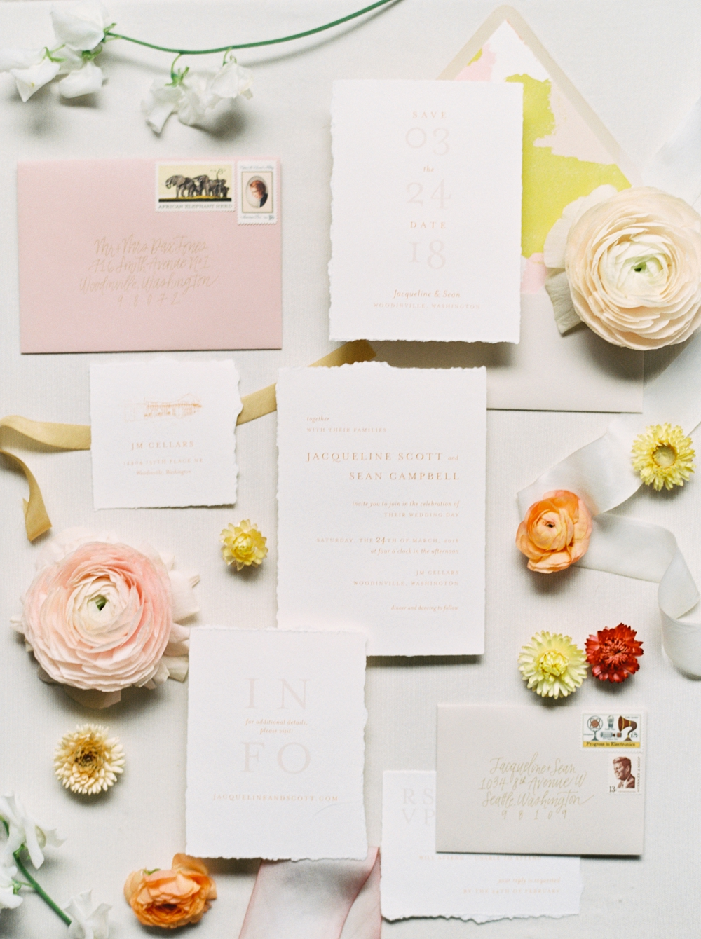 wedding-invitations-surrounded-by-flowers