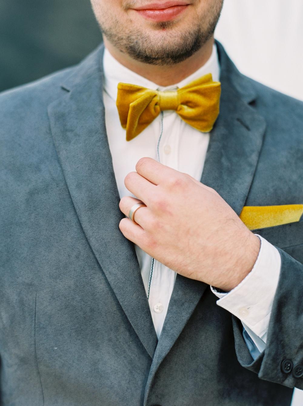 groom-straightening-yellow-bow-tie