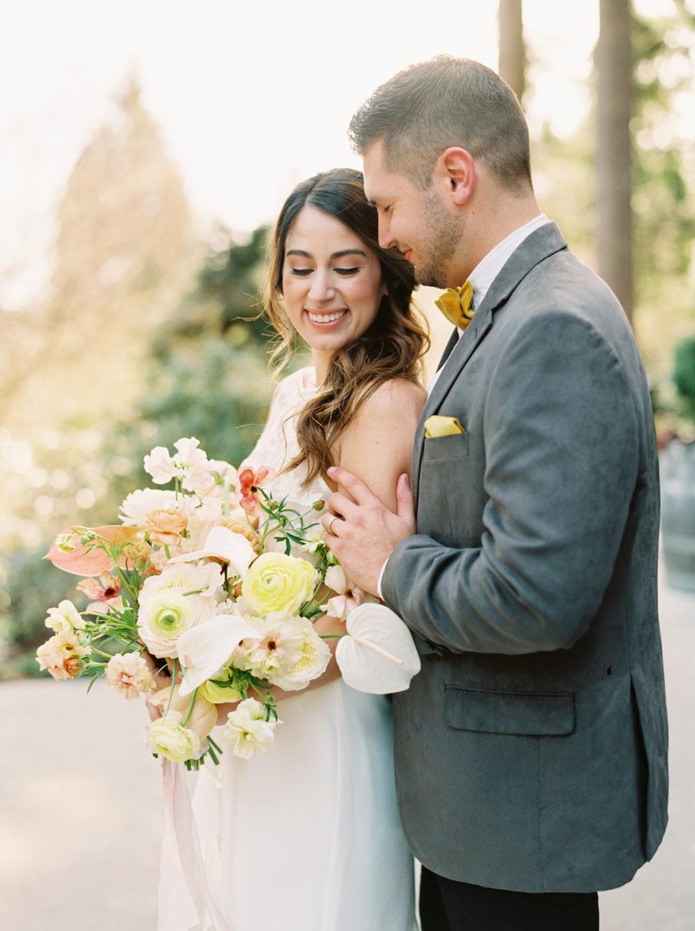 groom-looks-lovingly-at-bride
