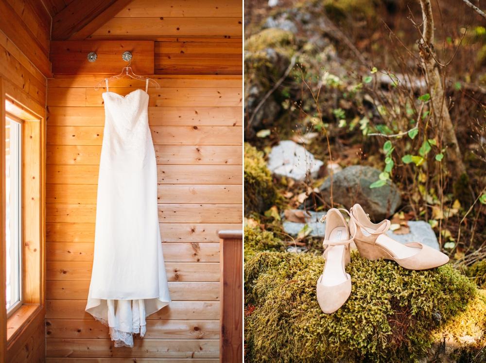 strapless-wedding-dress-hanging-against-shiplap