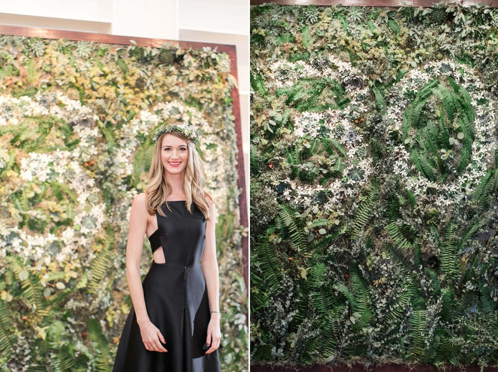 woman-stands-in-front-of-floral-wall