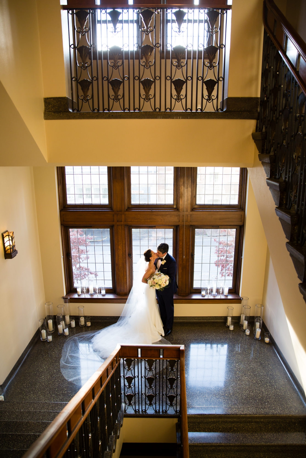 bride-and-groom-kiss-in-stairwell