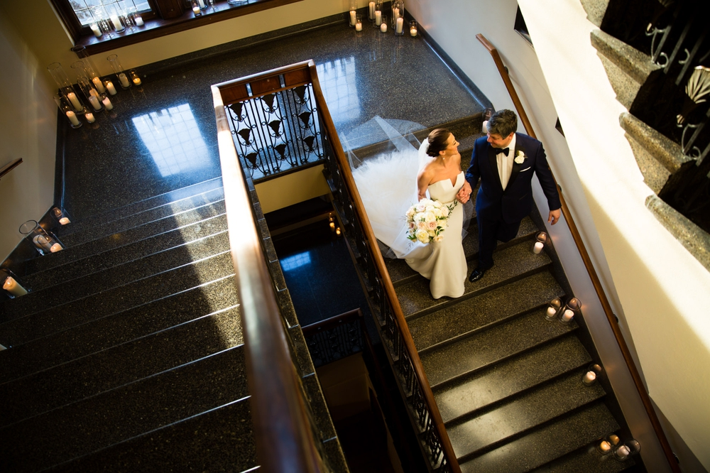 bride-and-groom-walk-down-stairs