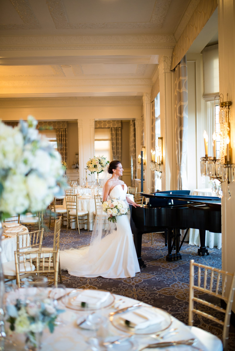 bride-leans-against-grand-piano