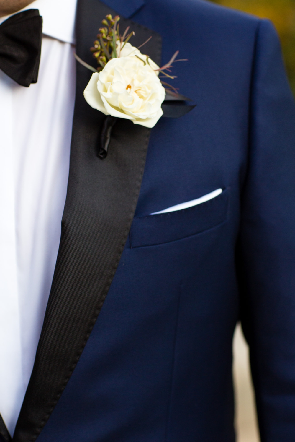 blue-tux-with-white-boutonniere