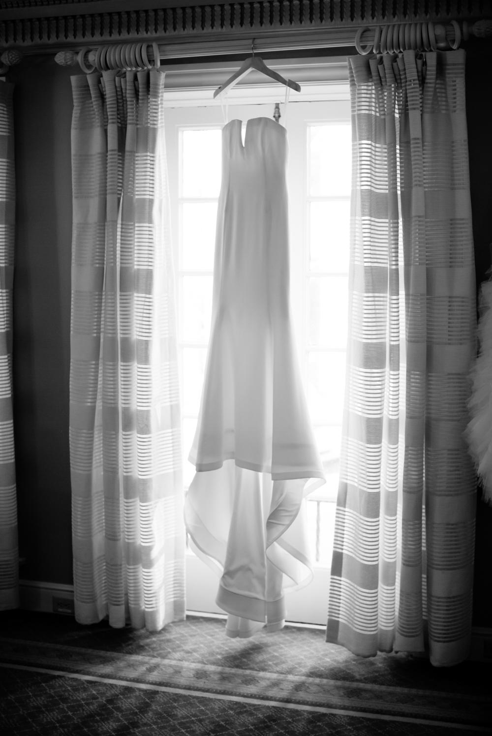 strapless-sheath-dress-hanging-in-window