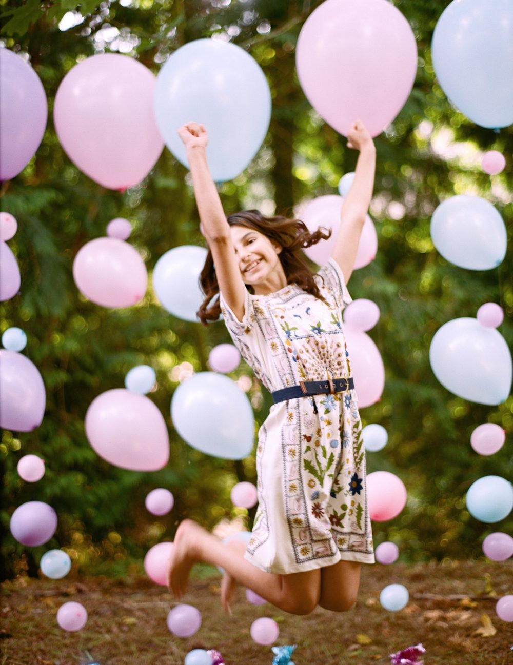 girl-jumps-in-front-of-balloons